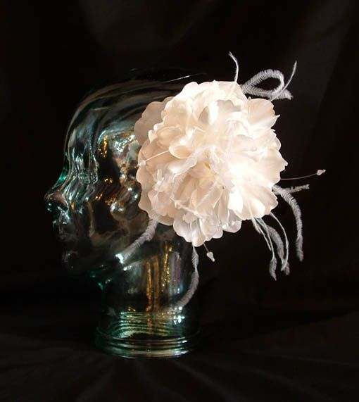 Silk flower with crystal stamens and ostrich feathers. $85 CAD (2013)
