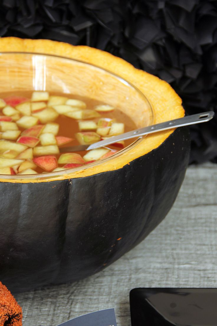 spray paint a pumpkin to create a dramatic black punch bowl - Halloween Punch Bowl Recipes