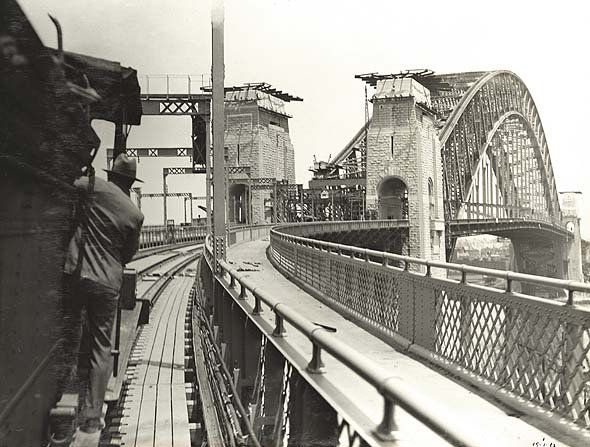 19 January 1932 the first train crossed the Sydney Harbour Bridge,comprised two vans, and carried a few privileged persons. The journey was made to test certain railway expansion points.