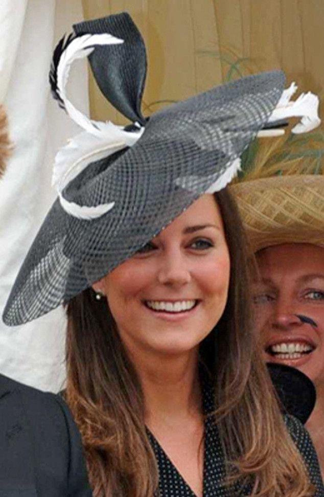 In Fine Feather from Kate Middleton's Hats & Fascinators  Kate dons a mesh black saucer with bold feathered detail back in 2008.