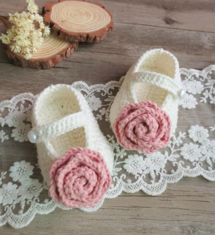Hand Knitted Baby Shoes-Handmade - Cute & Comfortable Newborn Baby Pre walker Infant Hand Knitted Flower Baby Booties Beautiful gift for a special newborn baby girl. Perfect for communion, baptism, christening & baby shower gift. Available in sizes newborn to 12 months. Material: Wool & acrylic. Colors: Off white. Please do compare your little girl's foot length with our size chart.
