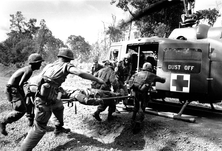 This photo shows the brave medical soldiers rescuing one of the injured.