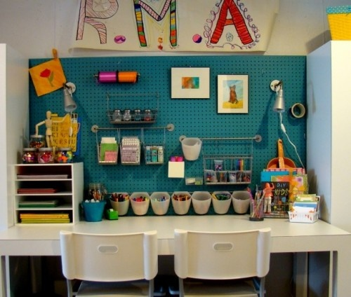 perfect kids craft area- well stocked- inviting- Peg boards make perfect backdrops to an art area. Not only can you add a variety of hooks and baskets to them but you can also paint them to make them look even more inviting.