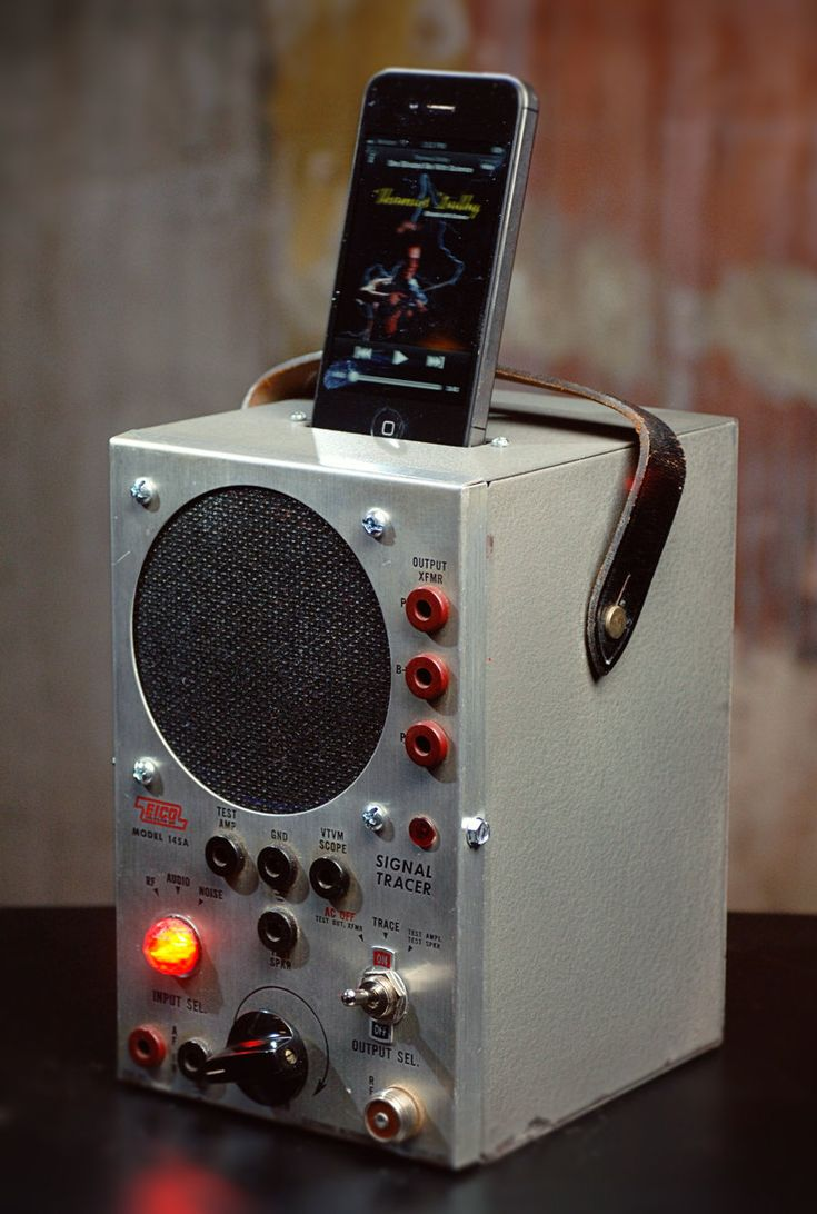 iPod/iPhone charging station with speakers from vintage radio test equipment.