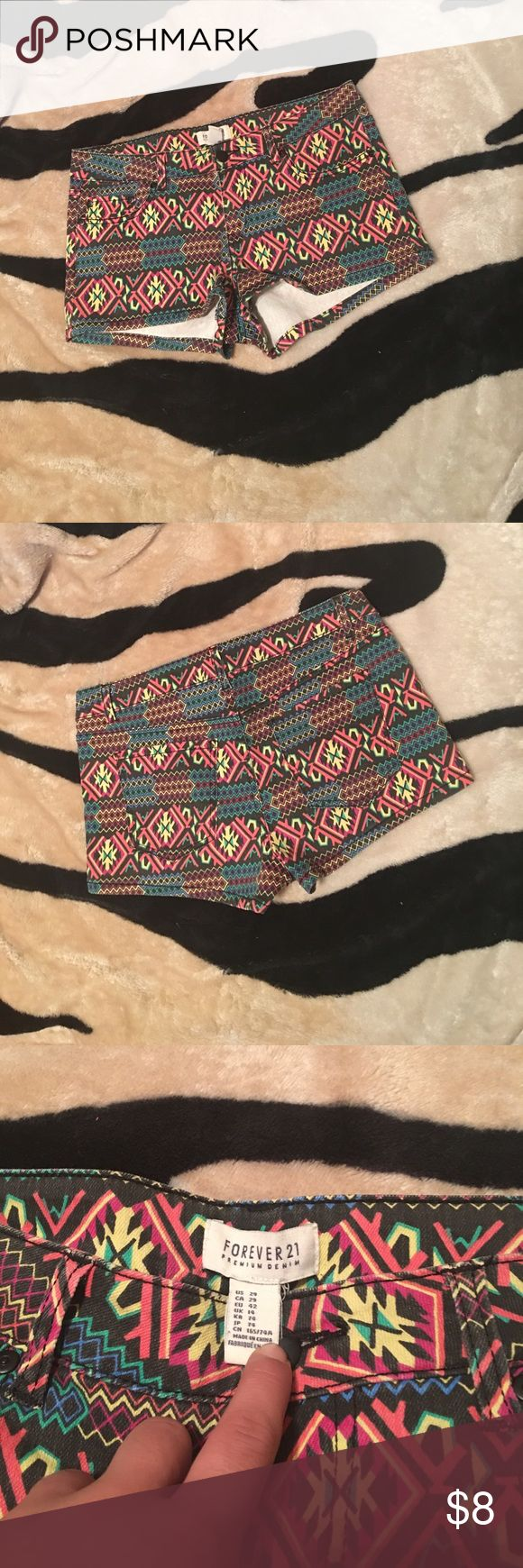 Forever 21 Aztec print shorts Size 29 Aztec print forever 21 shorts, mini length, but covers the butt! Pockets, lots of life left! Forever 21 Shorts