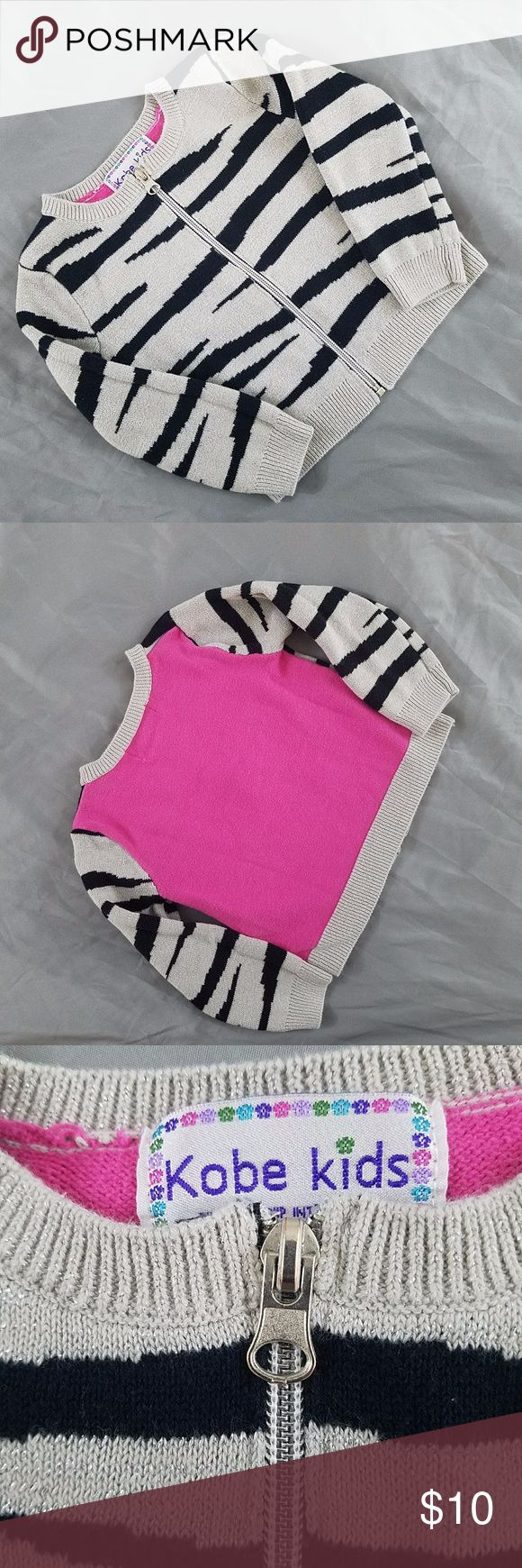 Kobe Kids Zebra Print zip up sweater. EUC no rips or stains. This is a super cute sweater its warm and has a nice feel.  From a smoke and pet free home Kobe Kids Shirts & Tops Sweaters