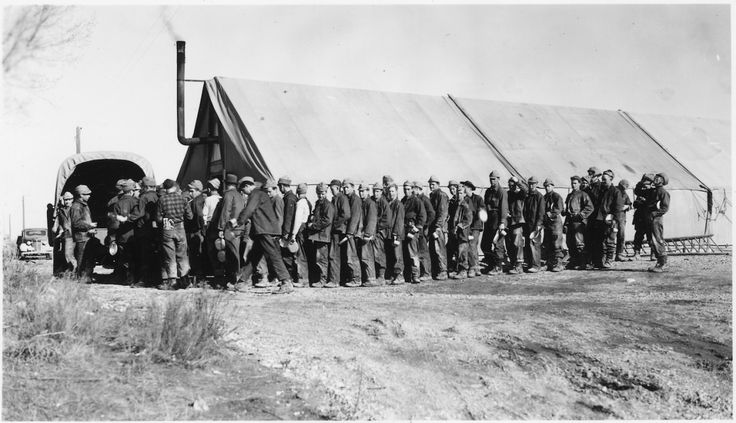 "CCC Camp BR-27 Minidoka Project, Burley, Idaho: ""Line-up for noon meal on the riprap project. Louis Petzoldt, photographer"" 2/6/1941 Series: Civilian Conservation Corps Photographs and Related Correspondence, 1939 - 1941. (US National Archives)"