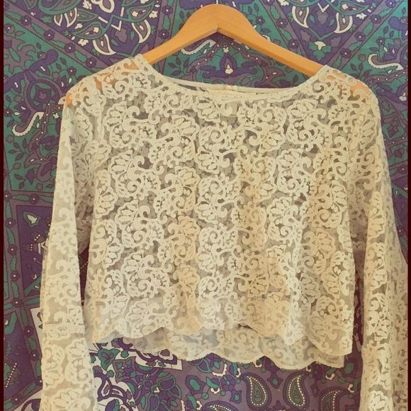 Silver Lauren Conrad Runway Scalloped Top This is an adorable shirt!!! Size XL, semi-sheer lace with bell sleeves and a scalloped hem. Never worn, new without tags. Just not really my style but an amazing limited edition top! Lauren Conrad Runway Tops Blouses