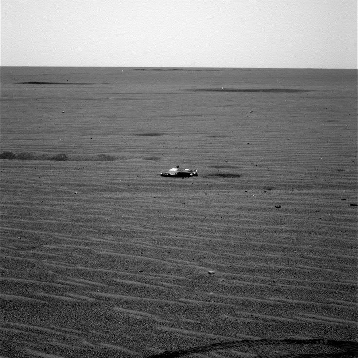 Mars metallic object – notice the rover track in the foreground. Considering the proximity of the object in the uncropped image, The definition seems uncharacteristically poor.