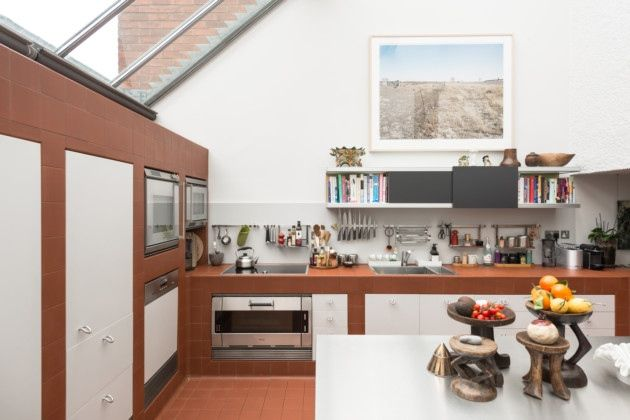 Red quarry tiles line the ground floor double-height kitchen and worktops