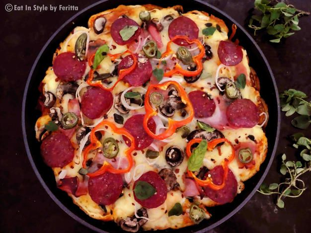 """Pizza Strata Bake - This pizza uses bread slices as the """"dough"""" to make a delicious, layered deep dish style pizza pie."""