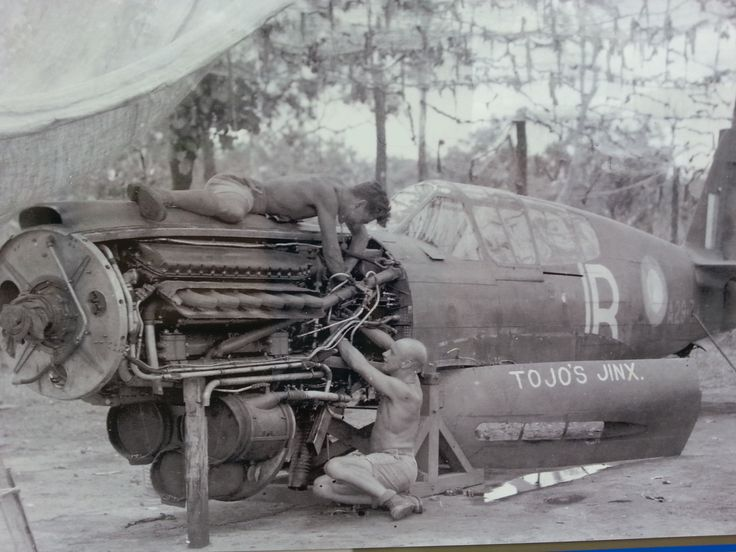 A Spitfire is repaired at Strauss Airstrip, Norther Territories, Australia in the late stage of WW2. Some of the spitfire models had problems with the high humidity. More on Strauss Airstrip on www.carnagegroup.com. WW2. Airplanes. Planes. Spitfire. Australia. RAAF.