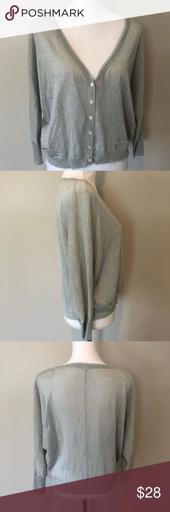 Free People Silver Metallic Cardigan Size M Silver/ metallic gray front button cardigan. Loose fit. Thin. About 22.5 inches across chest, 21 inches long. Free People Sweaters Cardigans