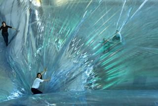 An art installation made adults feel like children again with a large suspended trampoline that gives the impression you're walking on air. The invention of Argentinian artist Tomas Saraceno, the   Year in Review 2012: Oddest Stories - Yahoo News UK