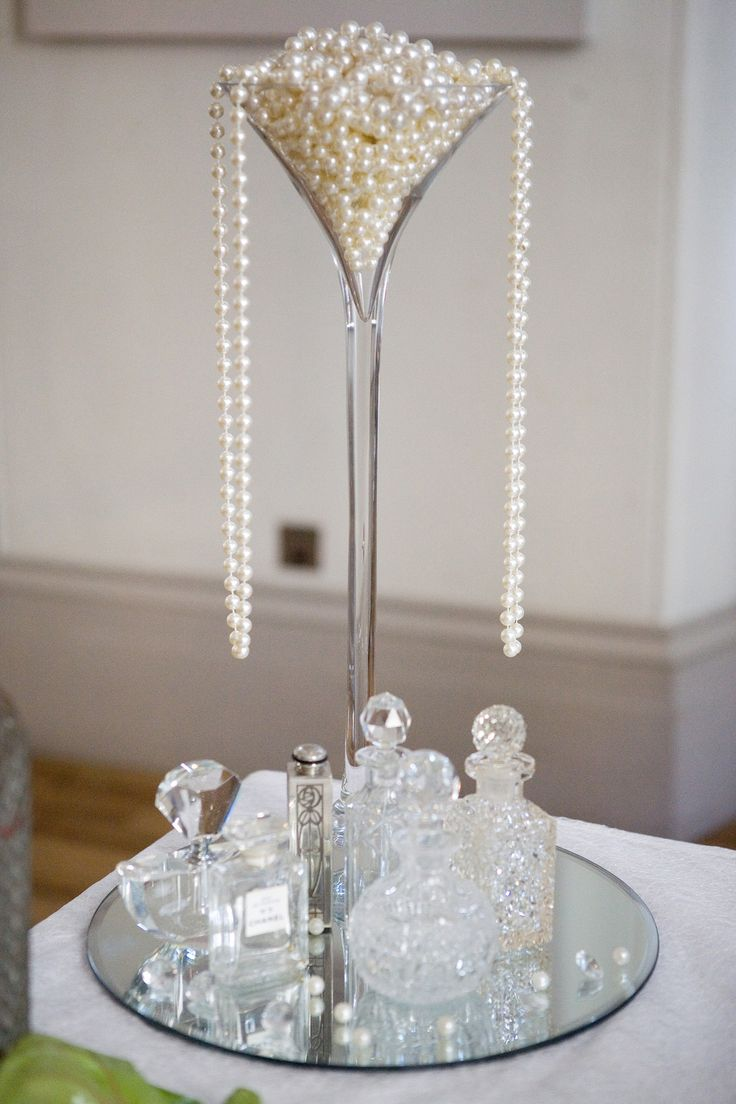 pearl dripping from champagne glass 1920's wedding style Downton Abbey wedding http://www.blushrose.co.uk/manchester-wedding-florist/ Great Gatsby 1920's wedding ideas themes