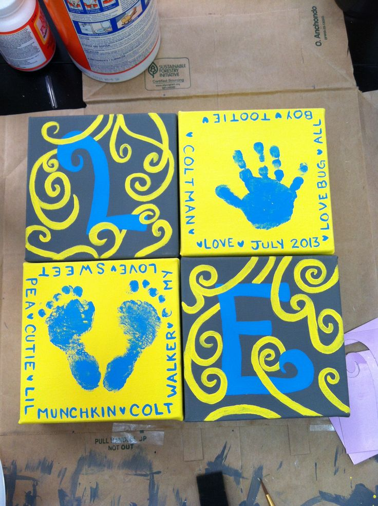 """""""Love"""" with my baby's hand and foot prints.   4 6x6 canvases and acrylic paint."""