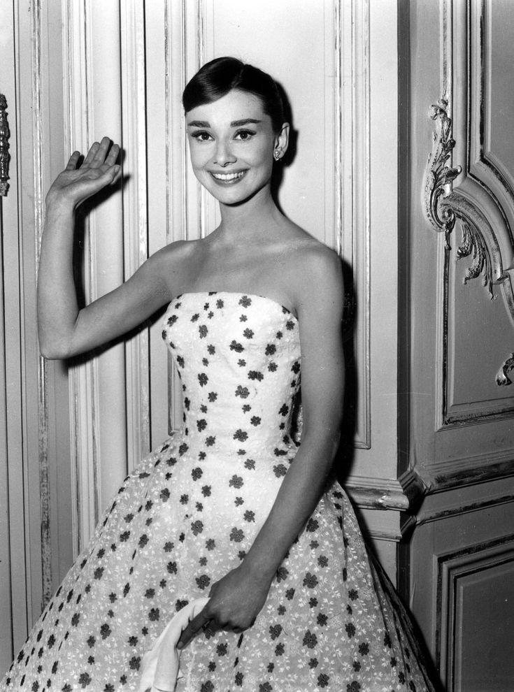 Audrey Hepburn is stunning in this sweet floral, flared skirted, strapless gown.. circa 1950's