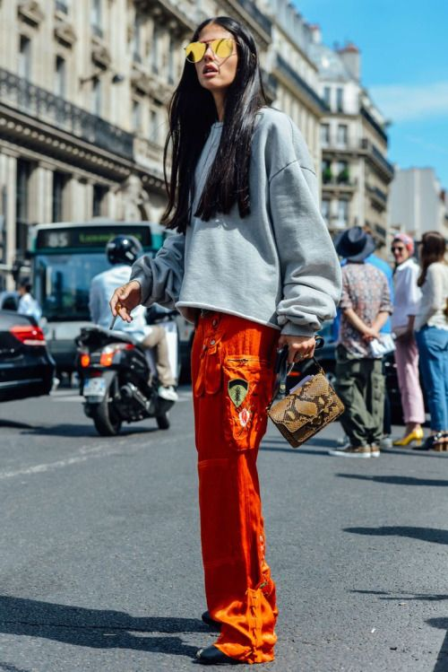 Pair silk pajama pants with a sweatshirt for a statement cool girl outfit
