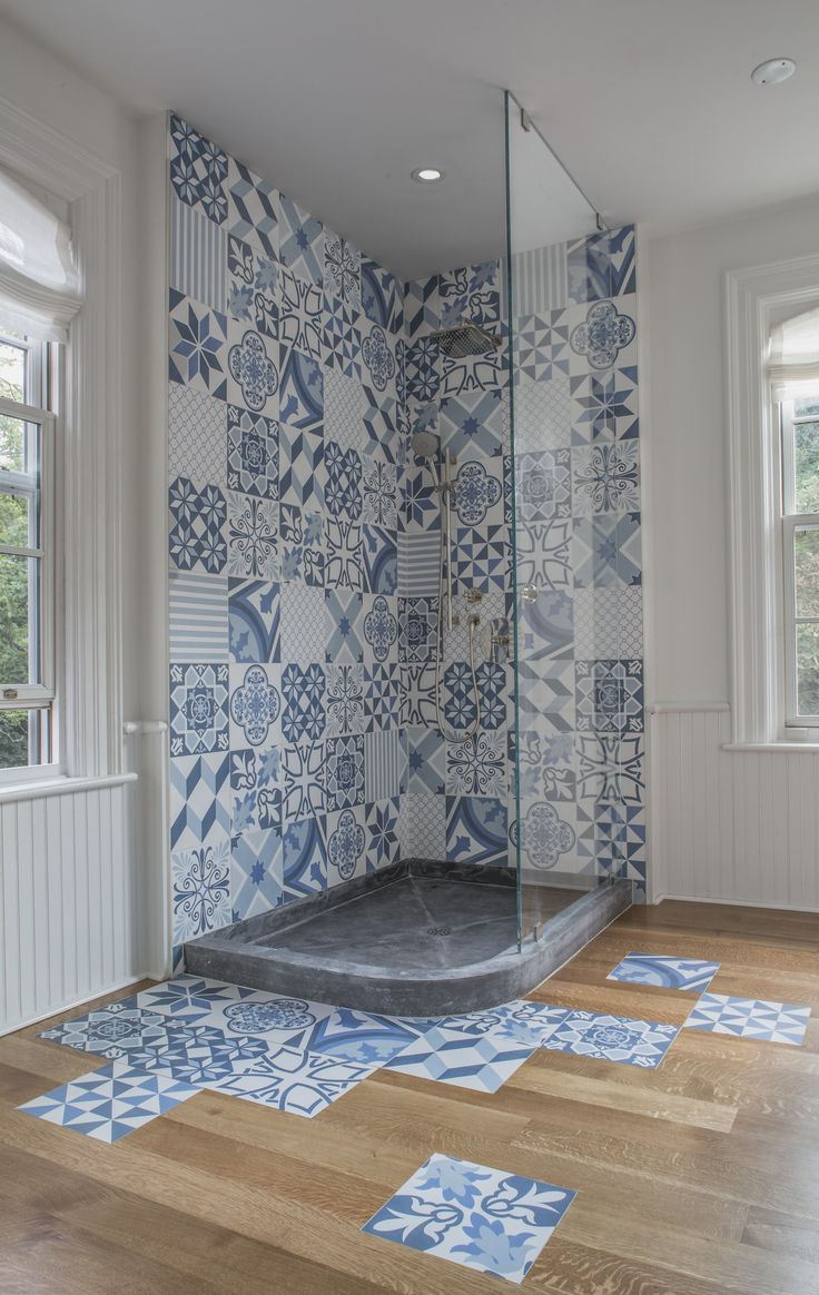 229 is a historic Arts and Craft style home built overlooking Lake Ontario in 1882. The guest en-suite features a custom shower pan and distinctive, playful ceramic Aparici tile floor splash. #shower #ApariciTile
