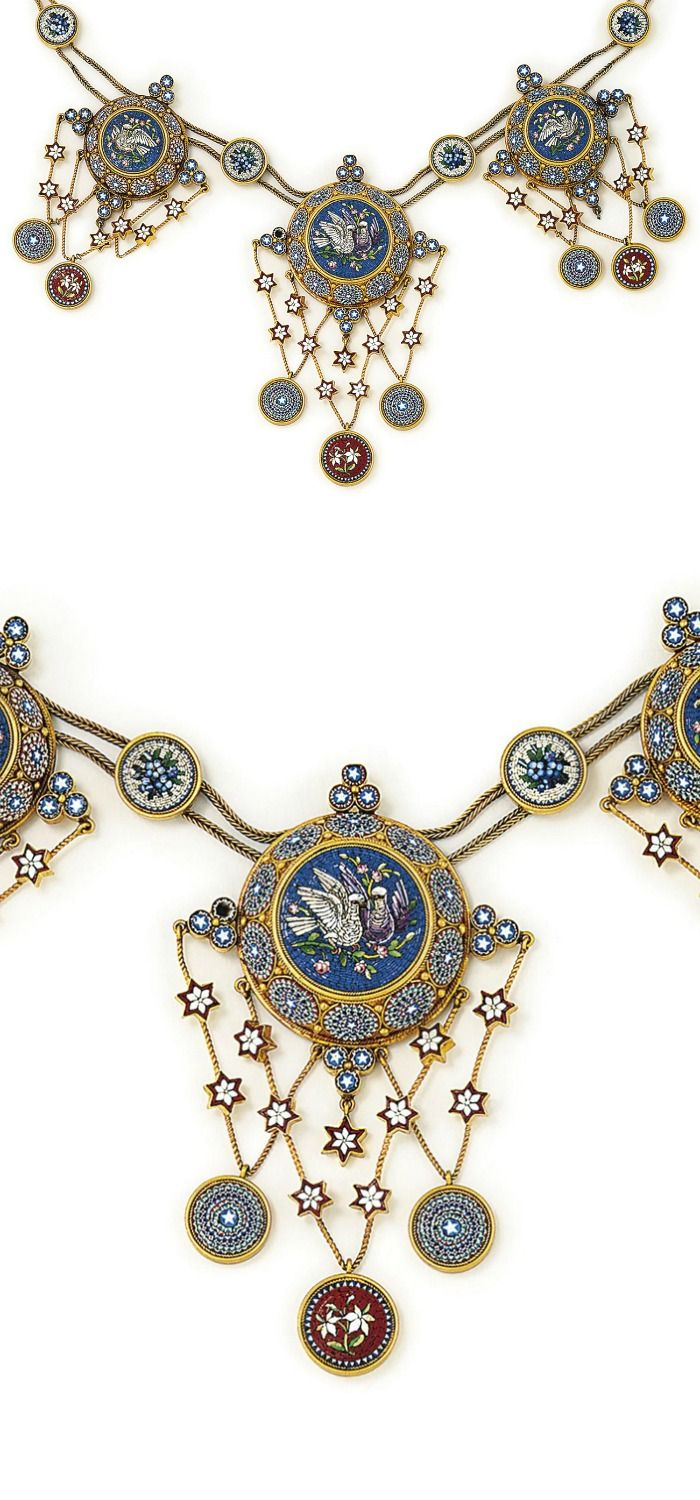 A 19TH CENTURY MICROMOSAIC NECKLACE:  The twin palmier-link chain with star-shaped micromosaic spacers to three graduated central domed plaques with dove motifs on a blue ground with foliate detail, within a micromosaic rosette surround, each suspending three rosettes from 'V'-shaped wires accented with star-shaped plaques and triple circular plaque surmounts, two pendant plaques deficient, some losses and repairs, circa 1870, 47.5 cm.  Via Christie's.