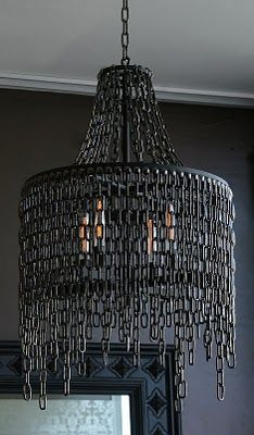 Chain link chandelier. We love chandeliers here at Octaspring, particularly black ones. This is industrial and striking would look great in our next photo shoot! http://octaspring.com
