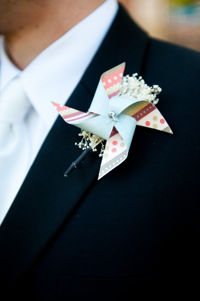 Pinwheel boutonnieres for a wedding held at Glen Echo Park, a former amusement park. Wedding Planning: Event Accomplished. Photo: Amie Otto Photography