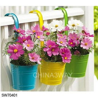 We have these colorful hanging pots at work!! Would be sooo pretty during summer!