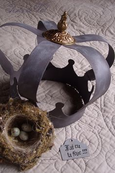 DIY:  Printable Template & Tutorial for making this  Crown out of Cardboard  - Direct link to PDF (in French, but easy to follow) is here:   http://ddata.over-blog.com/1/97/06/54//COURONNE-EN-ZINC.pdf