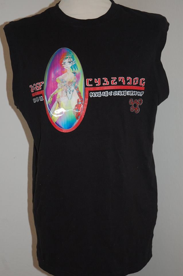 Black top with holographic print- see second photo for what the design changes too.