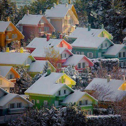 Lovely sugar coated, gumdrop houses brighten the winter's day in Bergen - Norway