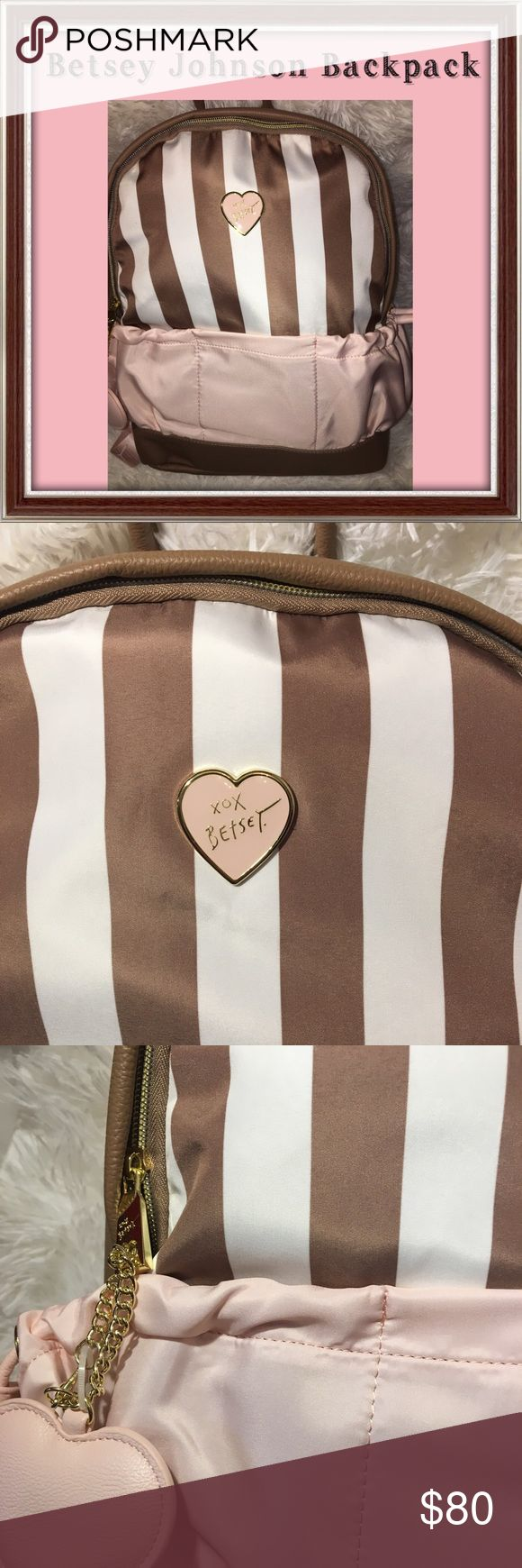 Betsey Johnson peach Tan cream backpack Absolutely unique and gorgeous Betsey Johnson 2-in-1 backpack. Has tan and white stripes with pink pockets on the outside. Outside pockets can be opened or closed. Has heart keychain. Body 100% polyester, trim 100% polyurethane. Lining 100% polyester. Can be carried by hand or on back! Has heart keychain. MSRP $98. Make an offer. If I accept, I will lower the price so you'll hopefully get discounted shipping! See my closet for lots of other Betsey…