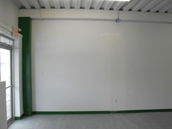 South wall, this will be the location for our hobby community notice board and the wall will be covered with slatwall for display of parts and pieces. This will become the main entrance to the store.