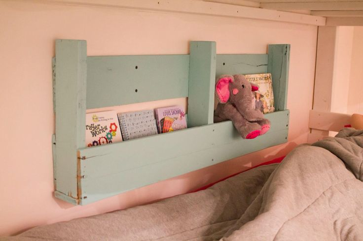 Pallet shelf that hubs made for kids bunk beds. Perfect for a bookshelf and a drink!