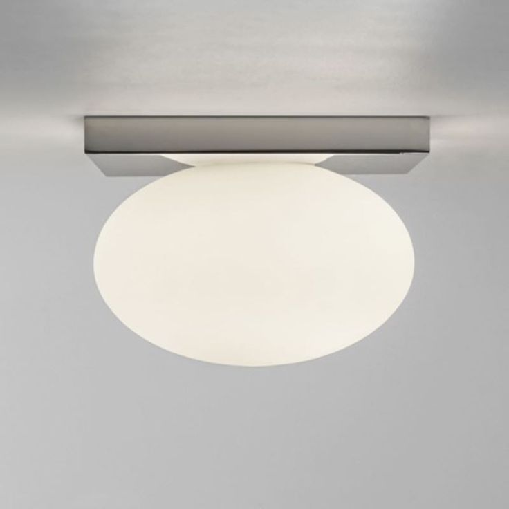 Astro Lighting chrome square bathroom ceiling light fixture with white oval glass diffuser from www.netlighting.co.uk
