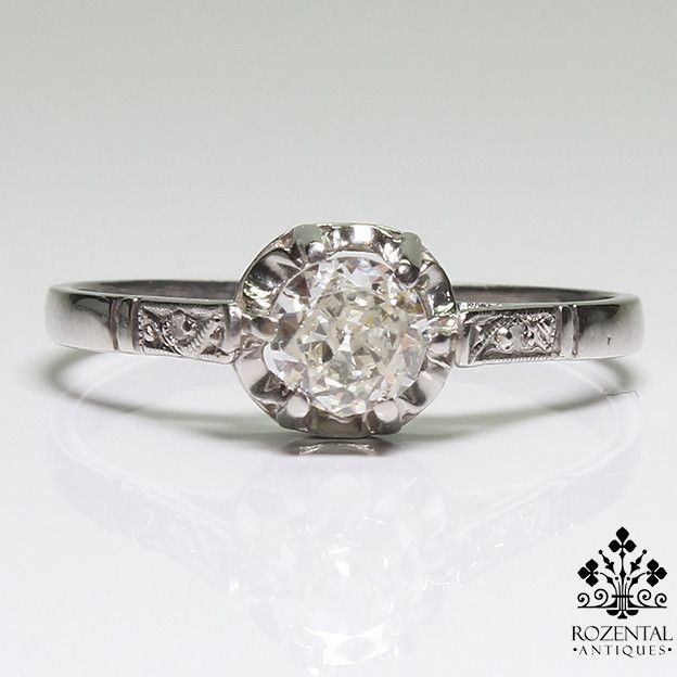 Period: Art deco (1920-1935) Composition: Platinum Stones: - 1 Old mine cut diamond of I-VS2 quality that weighs 0.40ctw. Ring size: 6 ¼ Ring face: 6mm in diameter. Rise above finger: 5mm Total weight