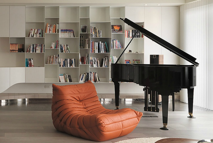 Ligne Roset Togo fireside chair, and baby grand piano.
