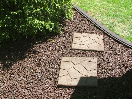 """Rubber mulch from """"Perfect Rubber Mulch"""" we will use in the landscape and rubber pavers to do the patio with."""