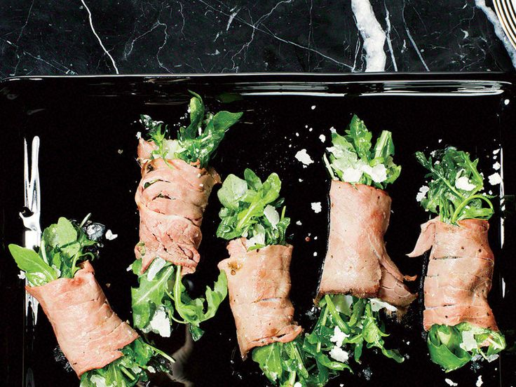 Finely sliced roast beef bundles leafy arugula for an easy yet elegant appetizer.