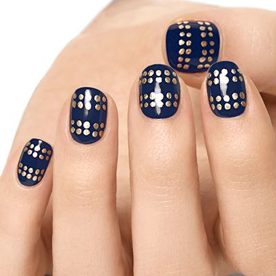 gold studded by essie - you've got an embellished luxe look all buttoned up with row after row of glittering gold studs.