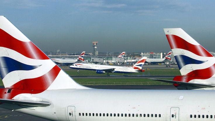 Two British Airways aircraft, with British Airways plane taking off in background.