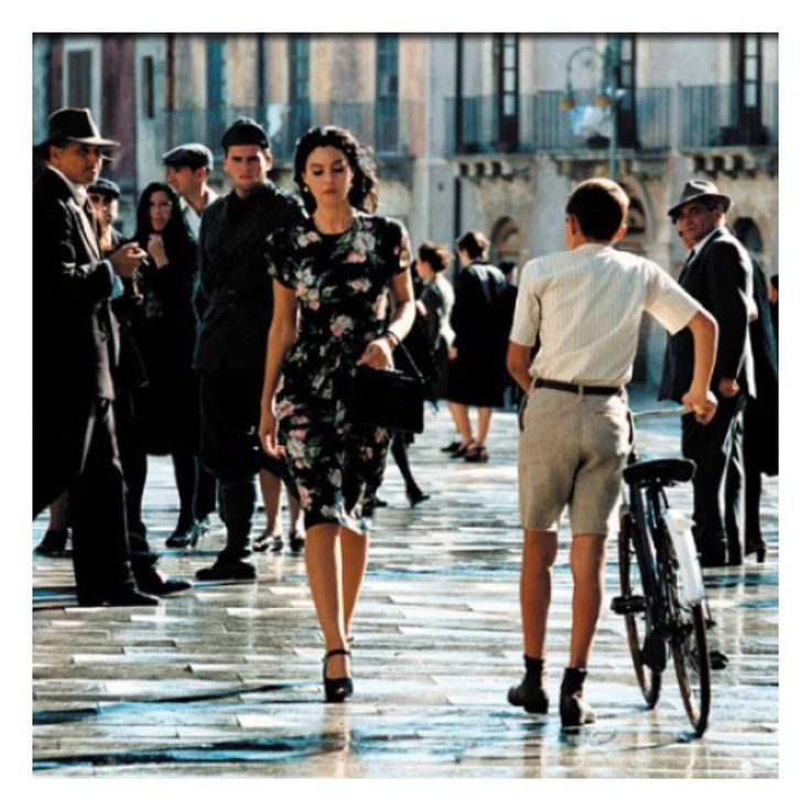 """Monica Bellucci in Italian masterpiece """"Malena"""" (2000), directed by Giuseppe Tornatore, plays a woman who is worshipped by men and hated by women for her irresistible beauty. Her attitude and reaction to the attention is reflected through clothes, therefore costumes in this film definitely matter."""