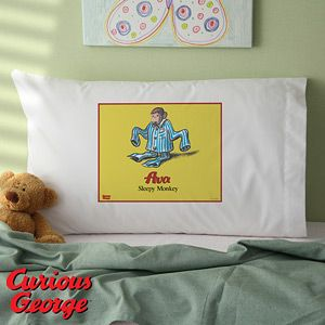 Curious George Personalized Pillowcase - Perfect addition to your child's Curious George Bedroom Theme! You can personalize this adorable pillowcase with their name for only $20.95! We LOVE the cute PJs on George! #CuriousGeorge #Monkey