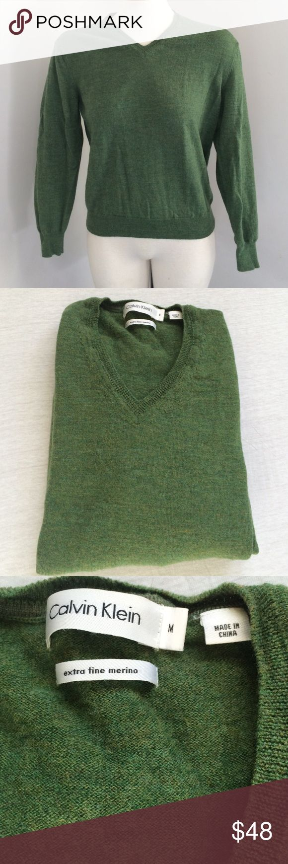 "🍃Calvin Klein 100% Merino V Neck Wool Sweater🍃 luscious merino wool, from Calvin Klein, in a heathered moss green will keep you warm and toasty through fall and winter. this V neck sweater won't give you the wool itchies so feel free to wear against bare skin or with a little cami underneath.  measurements: across shoulder 16"", pit to pit 18"", total length 22"". rubbed hem and cuffs. Calvin Klein Sweaters V-Necks"