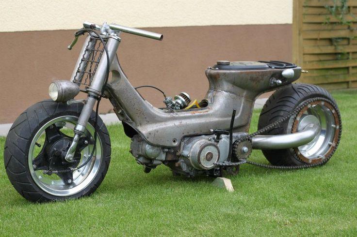 Raw metal Honda Cub custom with single-sided swingarm and radial-mounted rear…