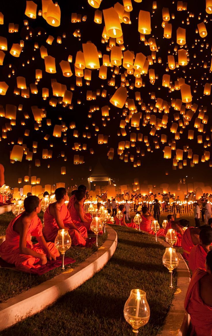 Floating lantern festival in Chiang Mai, Thailand. Released wish lanterns are symbolic of letting problems or worries float away