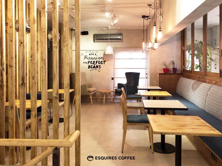ESQUIRES COFFEE ZAMZAMA | KARACHI | PAKISTAN _ Interior fitout _ Banquette seat #indoorseat #banquetteseat #tiledtable #woodentable #seating #armchair #woodenchair #concretewall #bulblight #woodenslats #coffeeshop #coffeeshopkarachi #esquirescoffee #zamzama #karachi #pakistan