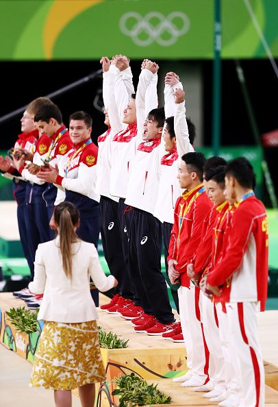 Gold medalists Japan celebrate on the podium at the medal ceremony for the…
