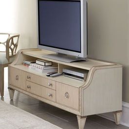 Traditional Media Storage... Looks like an old dressing table that has been revamped with the mirror removed!