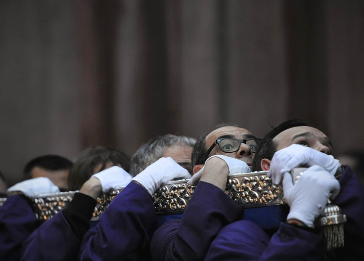 Penitents leave San Pedro church carrying a statue depicting Jesus during a Holy Week procession on Thursday in Madrid.
