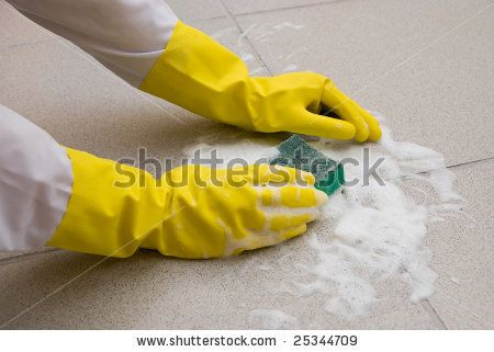 Hands in yellow gloves with sponge, washing floor - stock photo